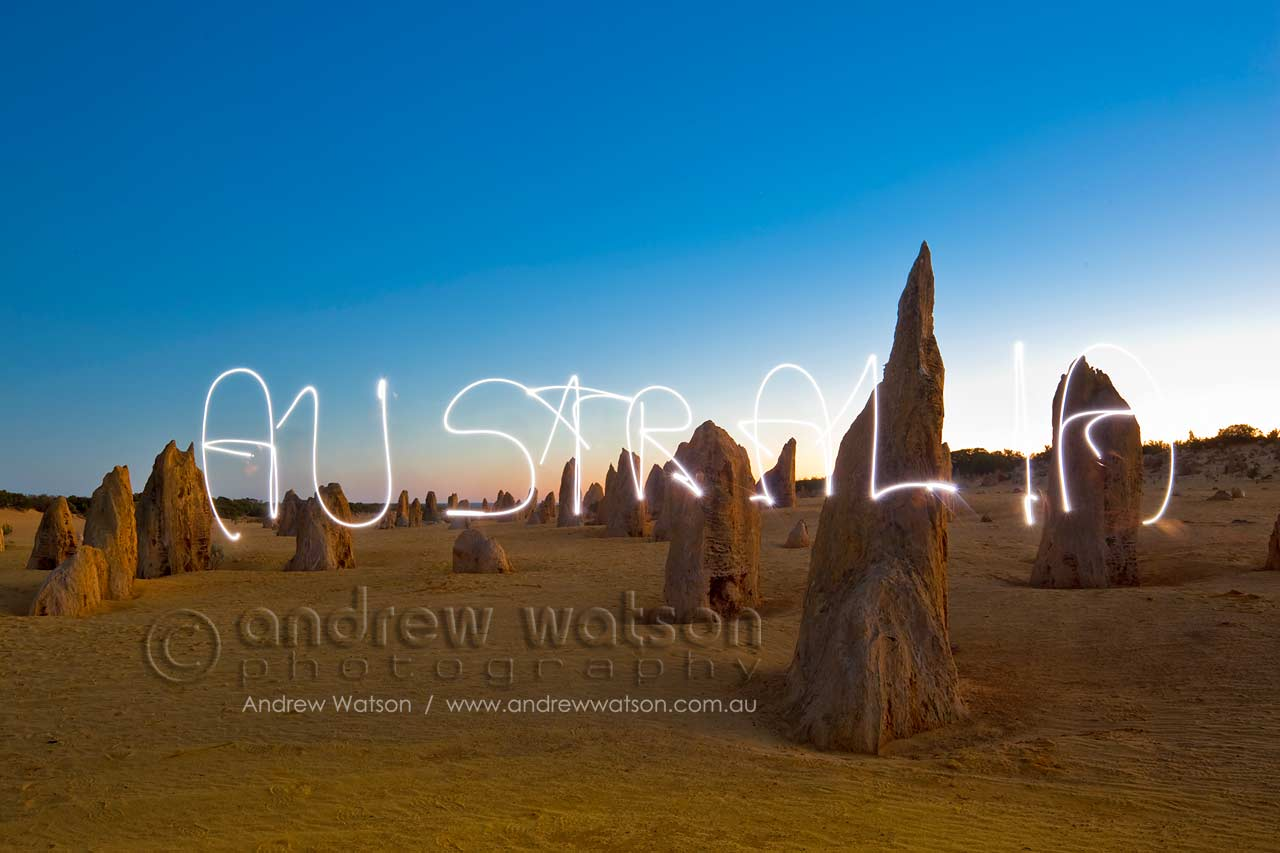Light painting in the Pinnacles Desert at twilight, Nambung National Park
