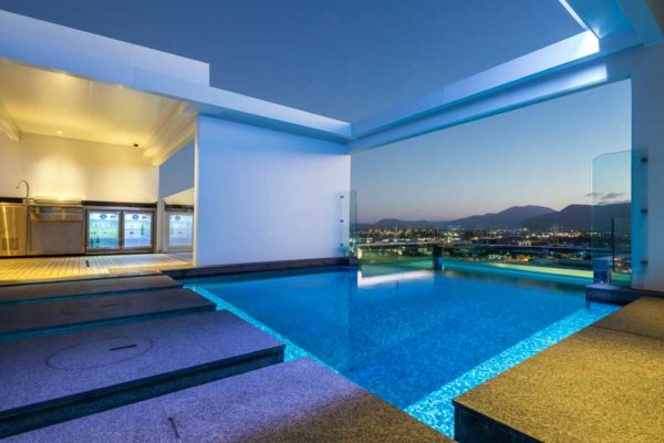 Architectural image of a residential apartment rooftop pool