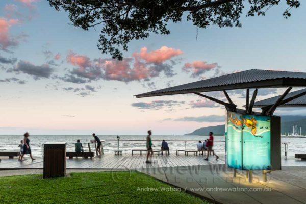 Busy scene along the Cairns Esplanade Boardwalk at twilight
