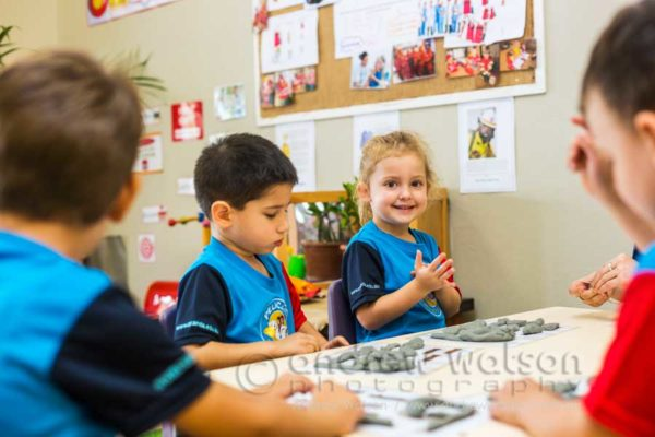 Children engaged in creative activities at Pelicans Childcare