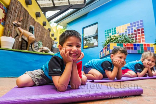 Children engaged in yoga class at Pelicans Childcare