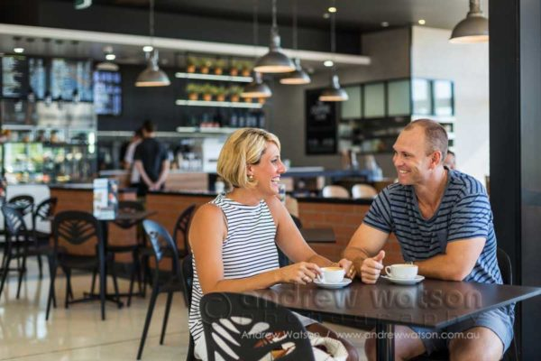 Lifestyle image of couple relaxing in a cafe