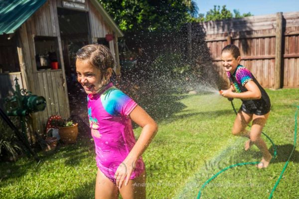 Lifestyle image of kids playing in backyard