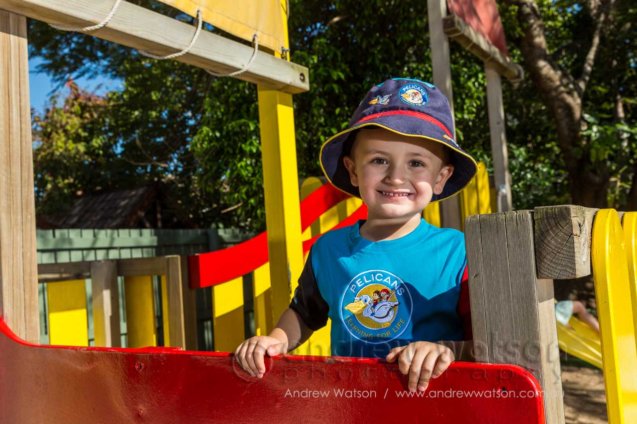 Child playing in the playground at Pelicans Childcare