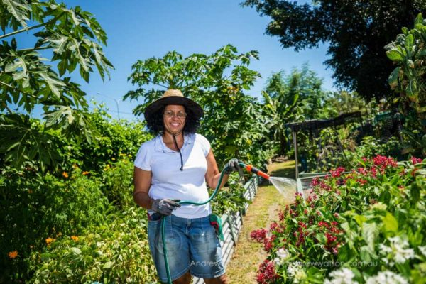 Kathrine Scott at the Community Garden, Bungalow, watering plants