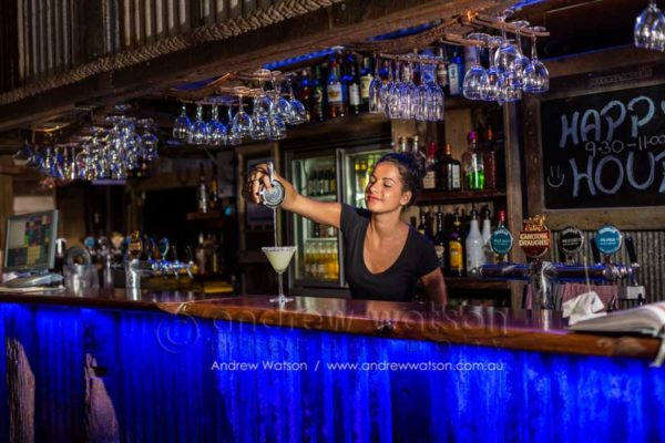 Waitress pouring a cocktail at the Iron Bar, Port Douglas