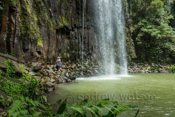 Visitor beneath Millaa Millaa Falls, Atherton Tablelands