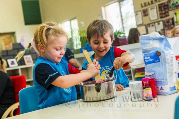 Children engaged in cooking activities at Pelicans Childcare