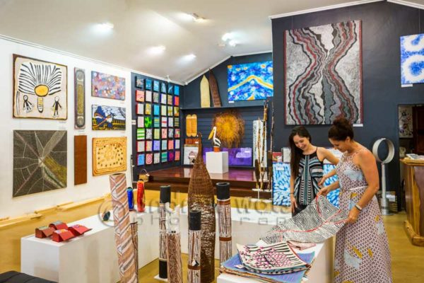 Woman shopping for indigenous art in Ngarru Gallery, Port Douglas