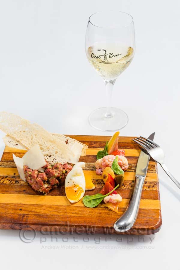 Image of beef tartar dish on wooden board