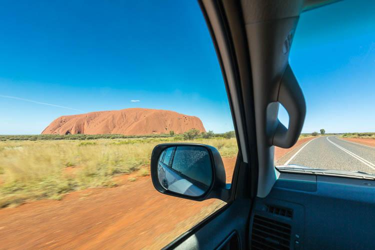 Image of Uluru through a car window