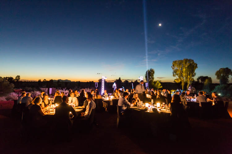 Image of diners under a night sky at the Sounds of Silence dining experience