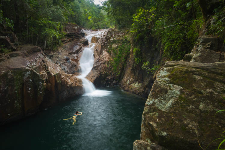 Image of woman swimming at Araluen Falls in Eungella National Park