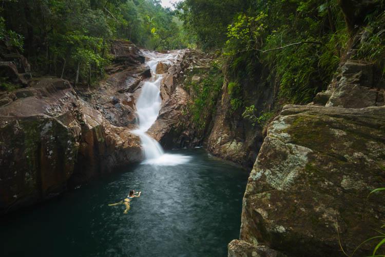 Image of woman swimming at Araluen Falls in Eungella National Park