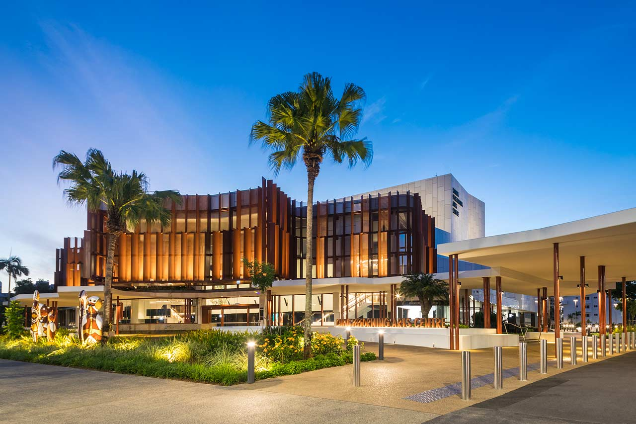 Exterior view of the Cairns Performing Arts Centre illuminated at twilight