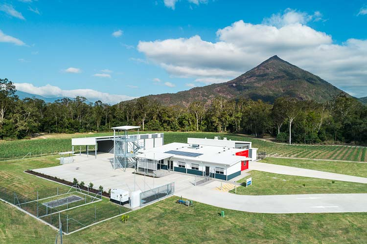 Aerial view showing Gordonvale Fire Station buildings with Walsh's Pyramid beyond
