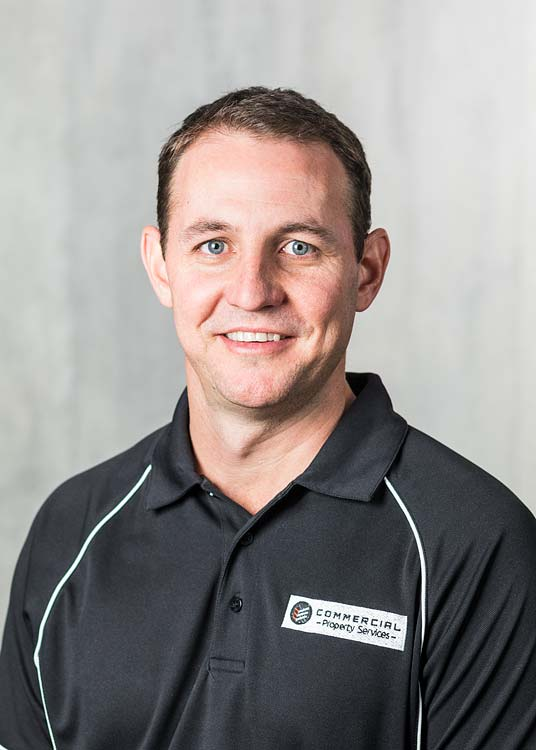 Corporate headshot of a male construction company manager