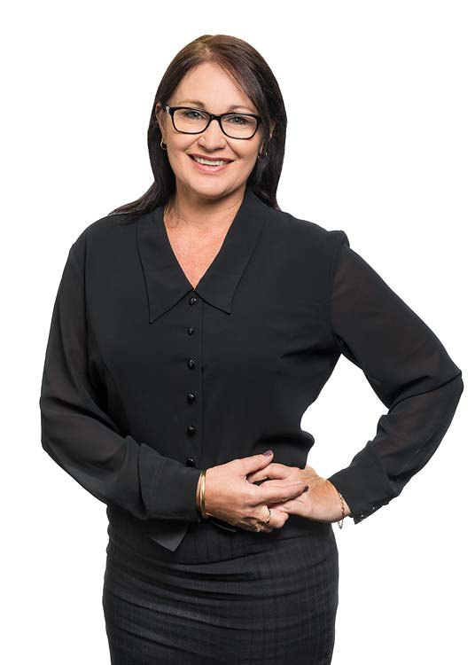 Corporate portrait of a female commercial property services agent with white background