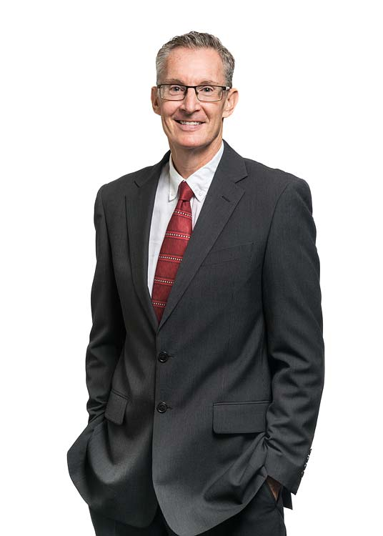 Corporate portrait of a male commercial property services agent with white background
