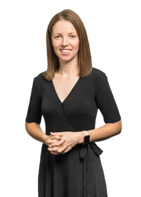 Corporate portrait of a female commercial property valuer with white background