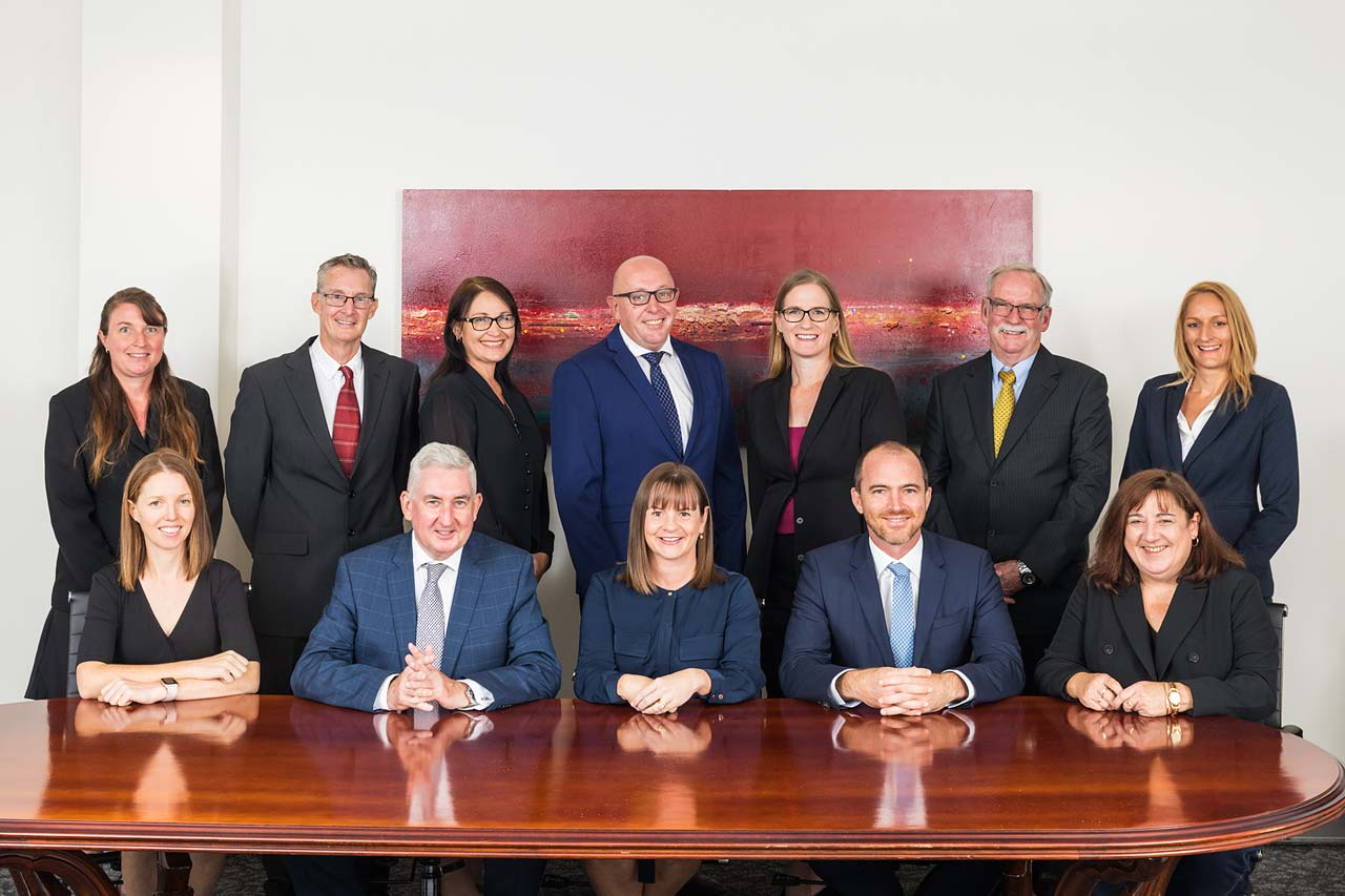 Corporate portrait of commercial property services staff in their boardroom