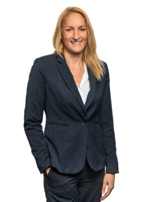 Corporate portrait of a female commercial property manager with white background