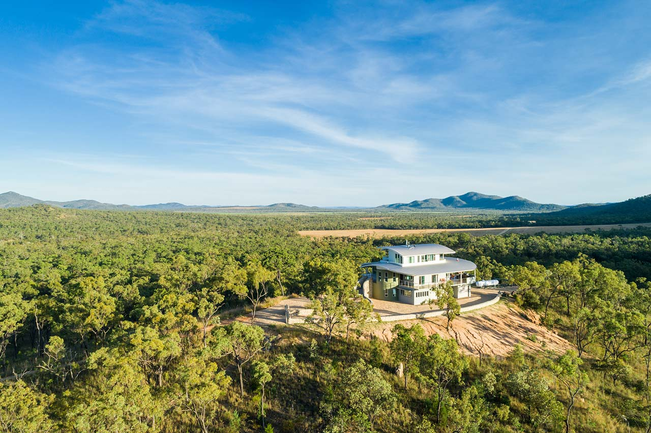 Aerial view of the Walsh River House and it's location surrounding savannah bushland