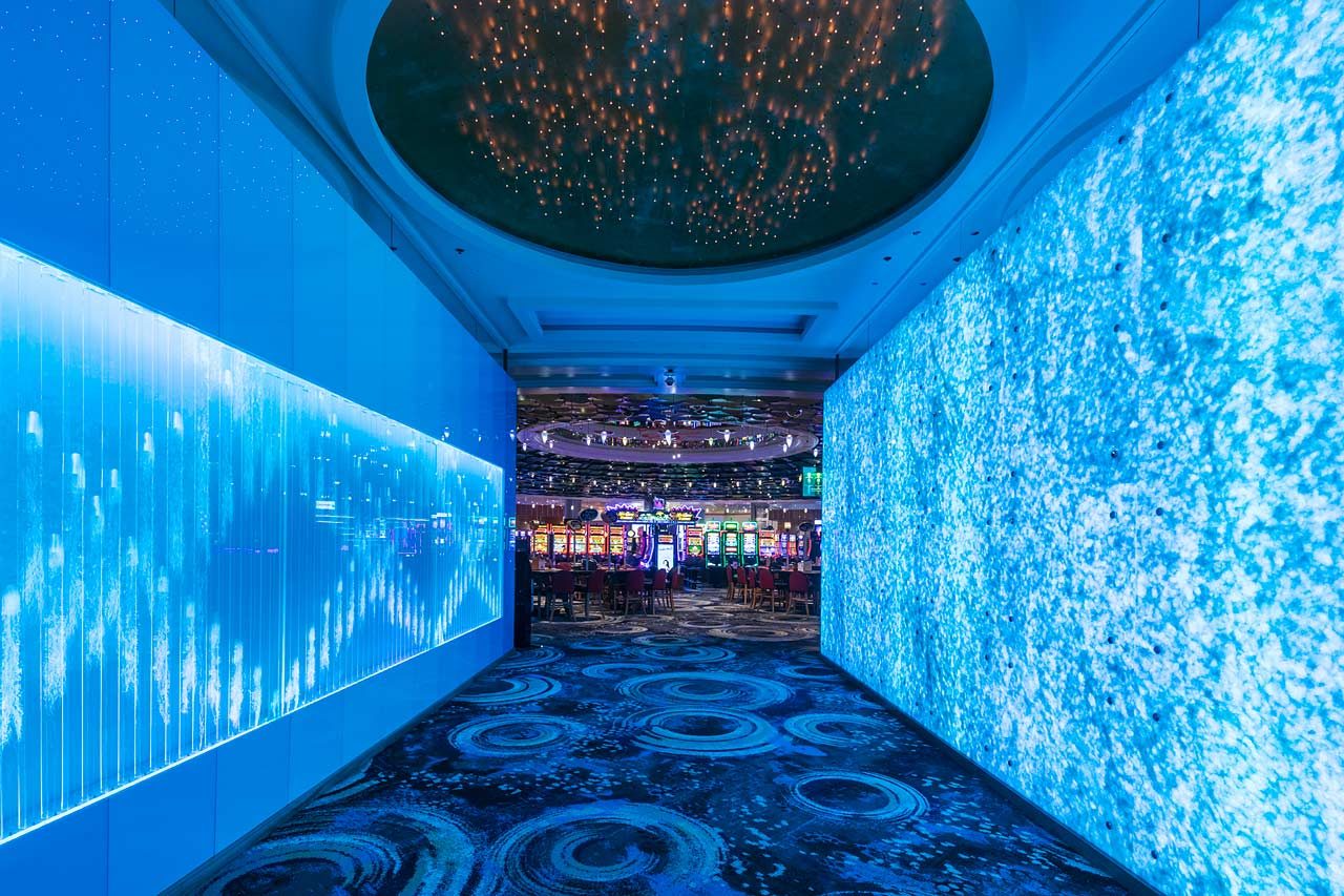 The Reef Hotel Casino gaming floor entry showing bubble and marble feature walls