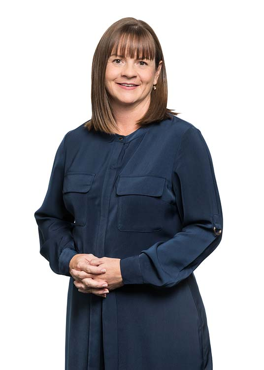 Corporate portrait of a female commercial property business manager with white background